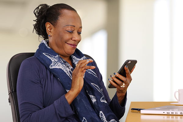 Happy woman checking her phone