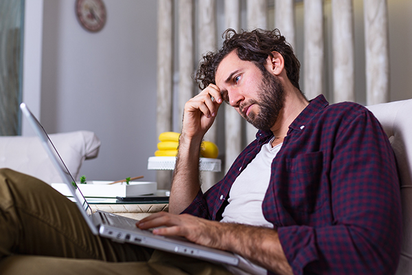 A  man considers whether to file Bankruptcy