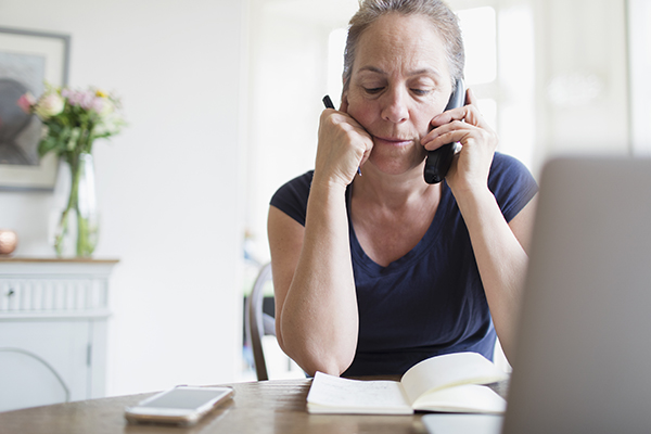 A woman negotiates her credit card debt over the phone