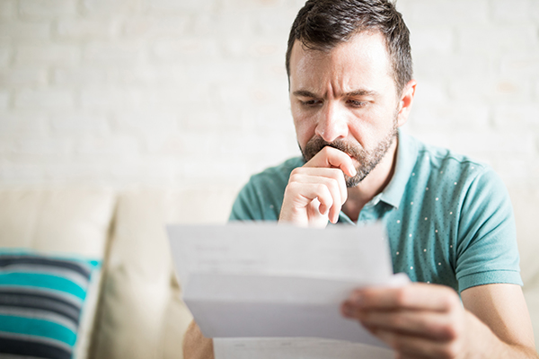 A man reads a notice of claim letter