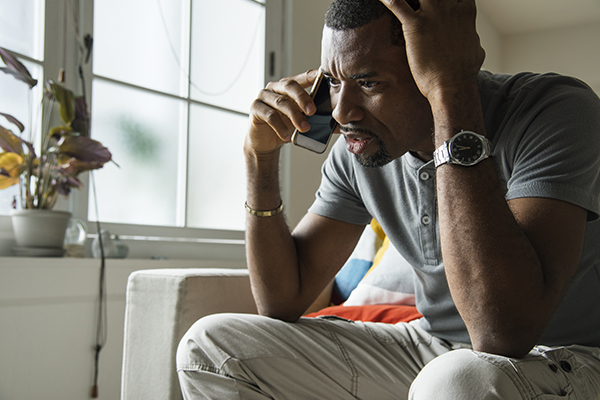 Worried man talking on phone